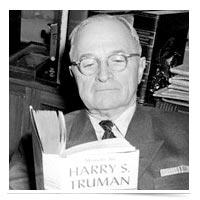 President Truman reading.