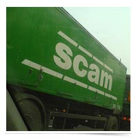 Truck with scam written on the side.