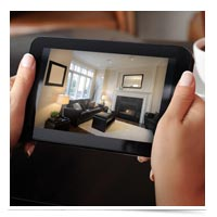 Image of woman monitoring home on iPad.
