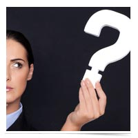 Image of woman holding question mark.