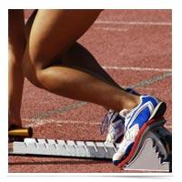 Image of sprinter at the starter blocks.