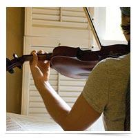 Image of girl practicing violin.