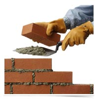 Image of hands laying bricks.