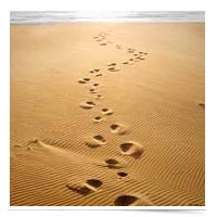 Image of footprints in the sand.