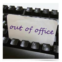 Image of out of office note in keyboard.