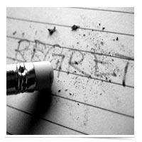 Image of REGRET being erased.