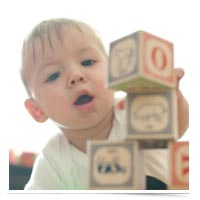 Child playing with letter blocks.