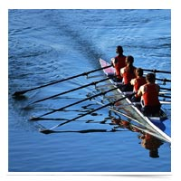 Crew rowing together.