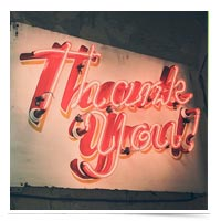 Thank you in a neon sign.