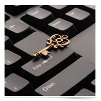 Golden key on a keyboard.