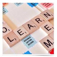 Scrabble letters spelling LEARN.