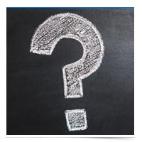 Question mark on a chalk board.
