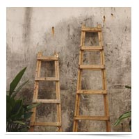 Ladders against a wall.
