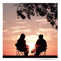 Couple meeting outside.