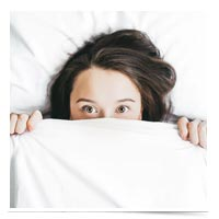 Woman hiding in the sheets.