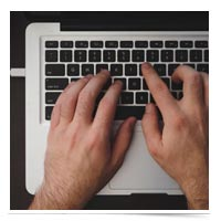 Typing on a keyboard.