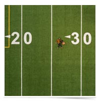 Man lying down on 30-yard line.