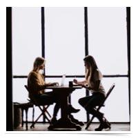 Women having a conversation.