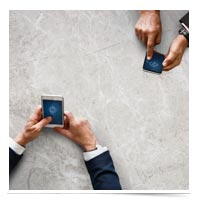 Men on smartphones.