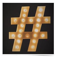 Hashtag sculpture lit up.