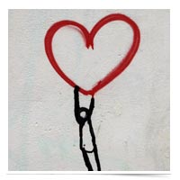 Painting of a stick figure holding onto a heart.