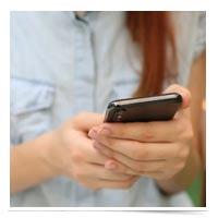 Woman holding smartphone.